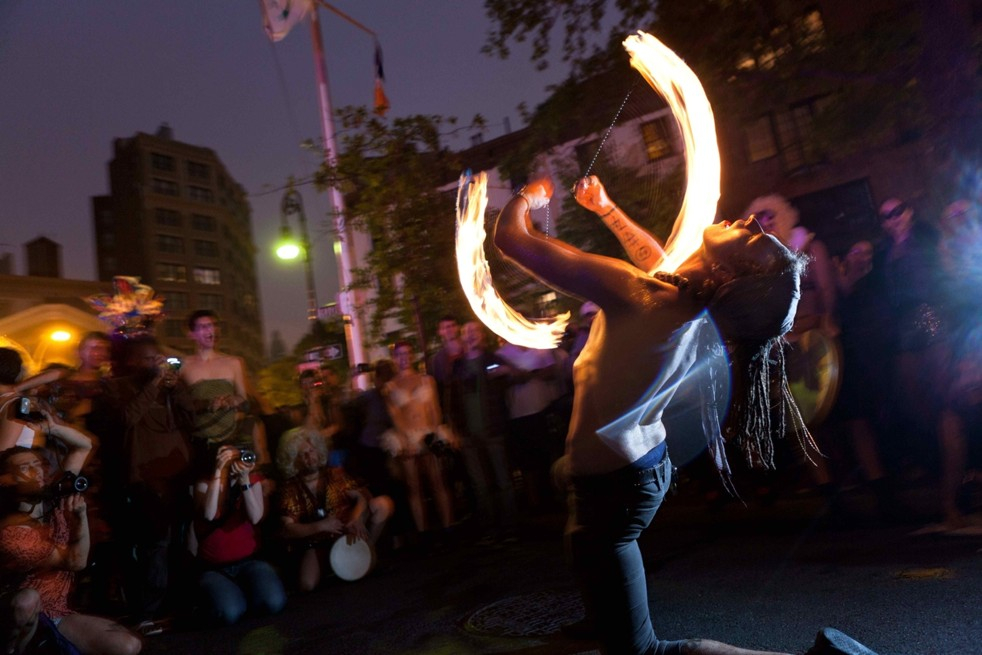 Fire Spinning at 2011 Drag March (AP Photo/ John Minchillo)